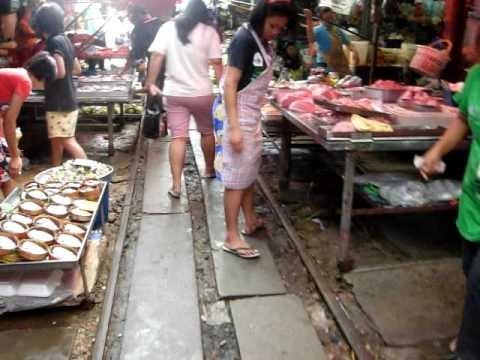 Maeklong Outdoor Market , Train goes through market