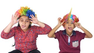 Indian siblings enjoying together while wearing colorful wigs - joyful concept