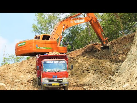 Excavator Top Loading Dirt With The Dump Trucks Doosan DX225LCA