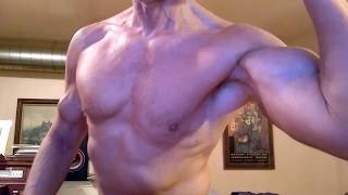 Intense muscle flexing biceps and arms.