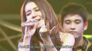 May J. sings a theme song of the Year End Charity 2010 with the chi...