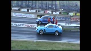 PT Cruiser races GT Mustang