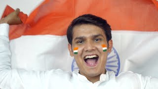 Indian man rejoicing the occasion of Independence day, Waving national flag - Patriotism