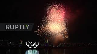 Japan: Tokyo marks 6 months to games with giant illuminated Olympic rings and fireworks