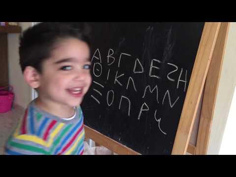 Giorgio writing the Greek Alphabet upper case