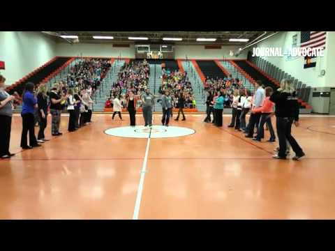Harlem Ambassadors help Ayres and Campbell Elemenary teachers show off their best dance moves during