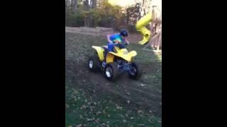 Quad drifts on a beat up honda 250
