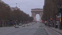 Champs Elysees in Paris virtually deserted due to shop, café closures | AFP