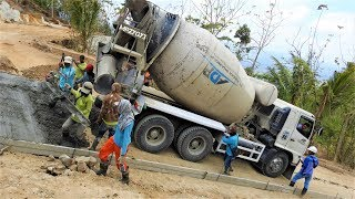 Extreme Concrete Paving On Steep Road By Hino 500 Ready Mix Cement Truck