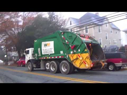 Waste Management Garbage Truck During The Foggy Day