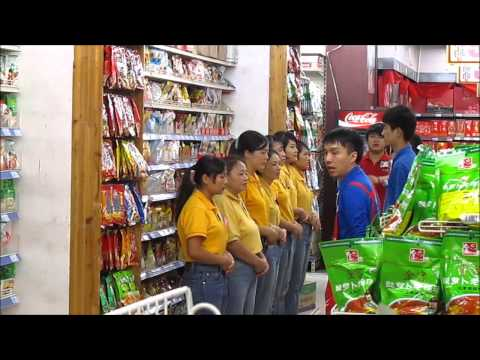 China - Supermarket personnel thanking customers for their visit