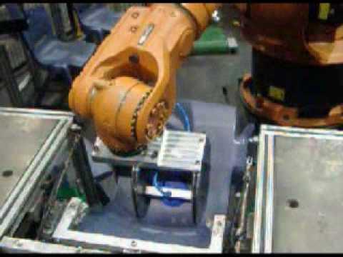 Kuka Robot Unloading an Injection Moulding Machine