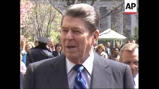 President Ronald Reagan speaks to reporters as he departs the White House
