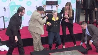 JERRY LEWIS supported by staffers when legs almost fail him thumbnail