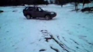 Freelander off road in the snow, hill decent control in action
