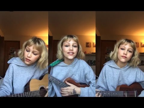 Grace Vanderwaal singing and playing guitar