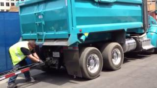 Double dump truck loads trailer