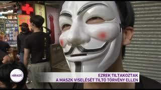 Ezrek tiltakoztak a maszk viselését tiltó törvény ellen