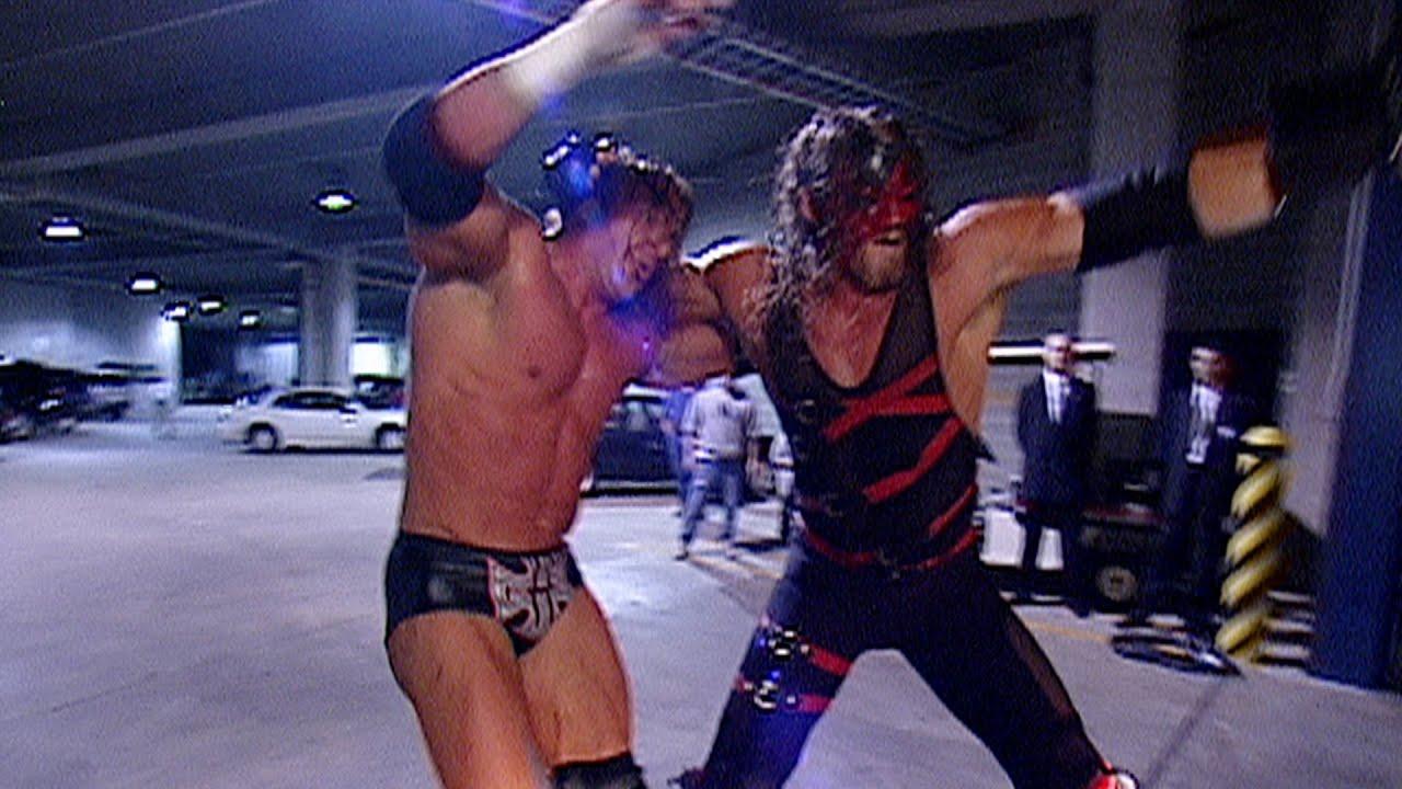 Kane chokeslams Triple H on a car: Raw, Oct. 21, 2002