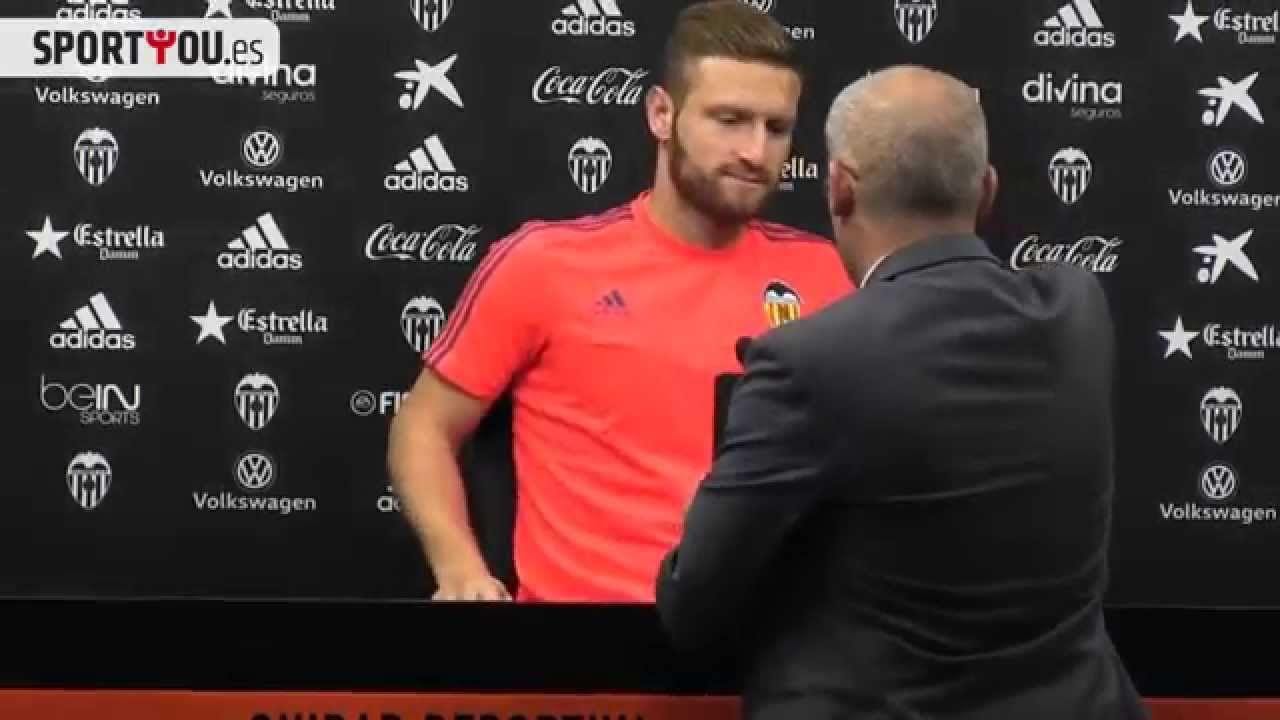 Shkodran Mustafi removes a bottle of beer placed in front of him