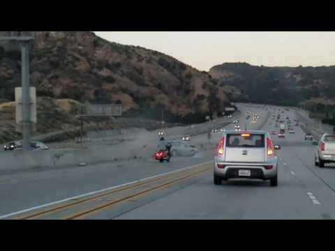 CALIFORNIA MOTORCYCLIST KICKS CAR CAUSING BIG ACCIDENT