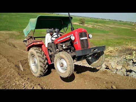 Super dam tractor driving MF 1035