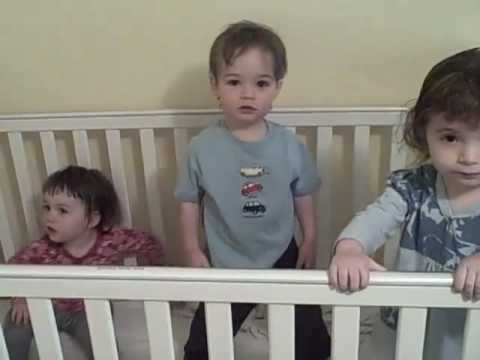 Three Toddlers in a Crib