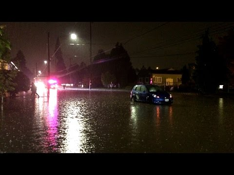 Flooding at 65th and Division stalls car