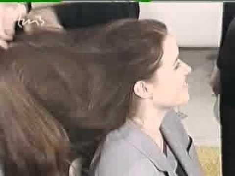 Hairdresser Brushing Long Hair Of Female In Hair Salon