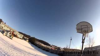 Amazing boomerang trick shot into basketball hoop