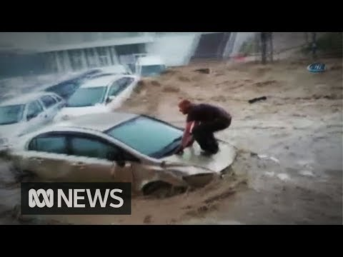 Man 'surfs' his car bonnet to escape as flash floods hit Turkish capital | ABC News