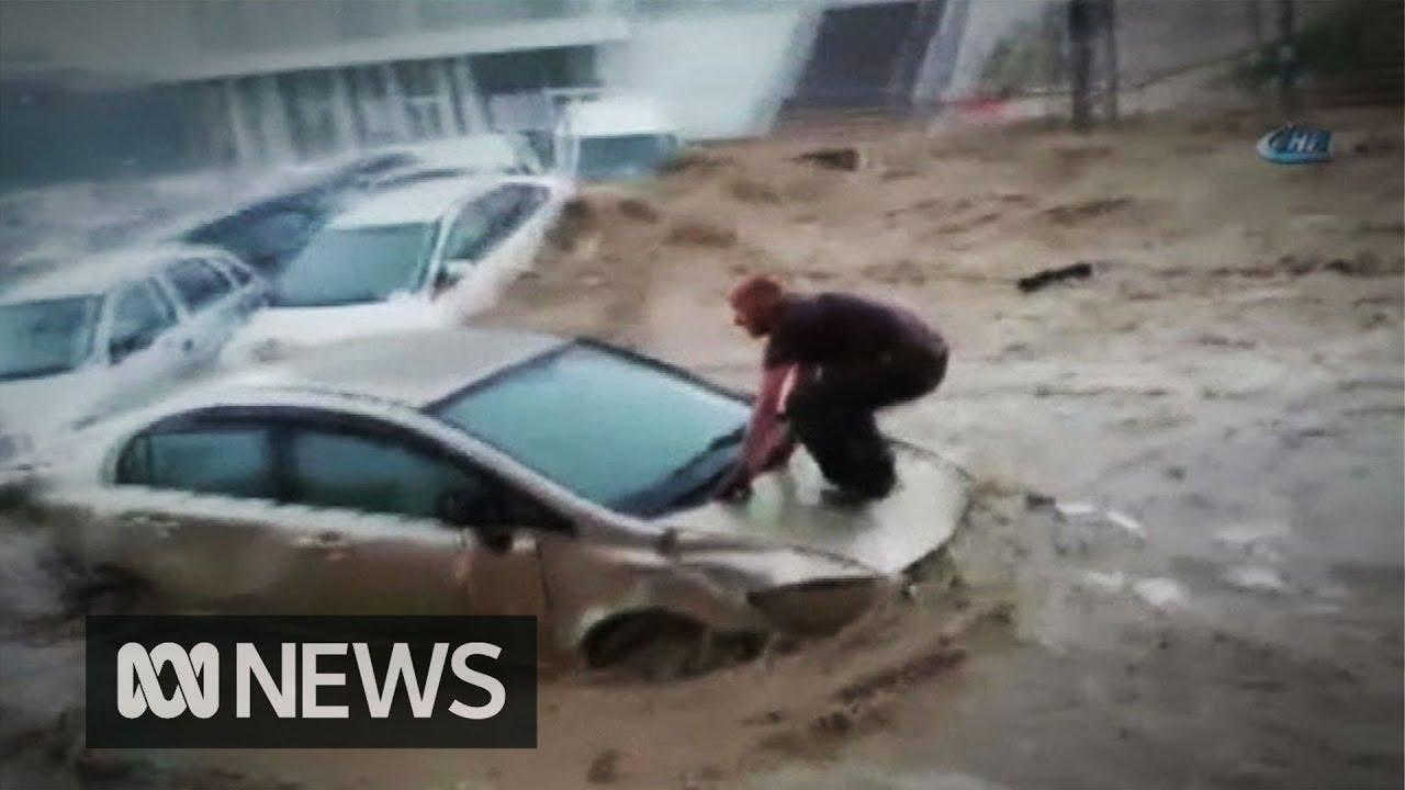 (TURKEY - May 2018) Man 'surfs' his car bonnet to escape as flash floods hit Turkish capit