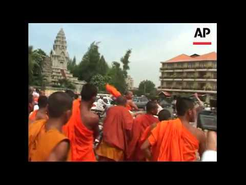Opposing groups of Buddhist monks engaged in a street fist fight