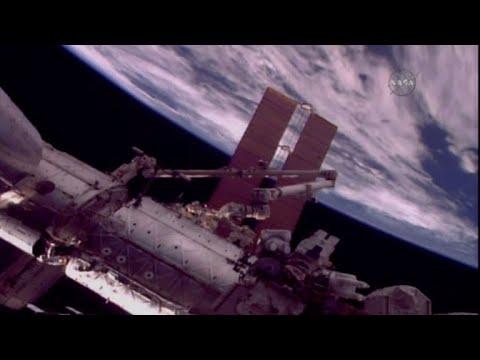 Two US spacewalkers start work on robotic arm repair