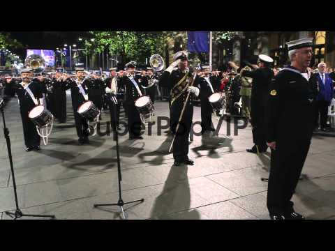 Long shot of army drummers saluting and playing drums.Aus...
