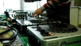 Dj  Mr White P spinning with four CD players