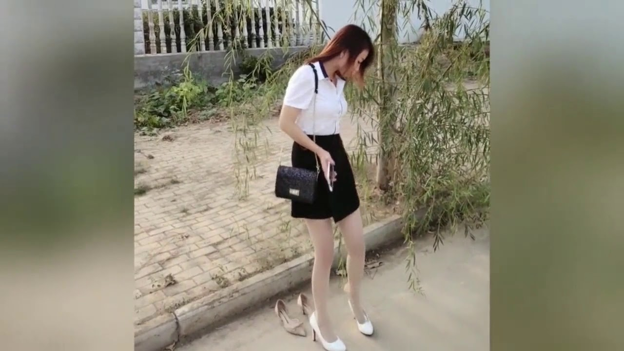 Girl changing  sexy high heels and showing her sexy barefeet
