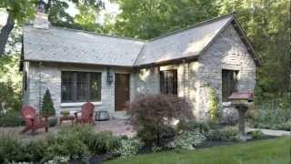 Old 1900's log gatehouse reinvented as an English-style Limestone cottage in Minnesota