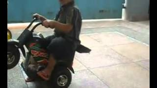 Three Year Baby Drive Motor Bike On One Wheel