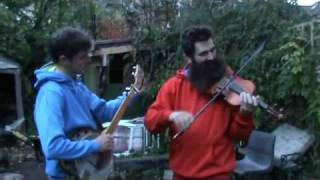 Ed Hicks (banjo) and Aaron Jonah Lewis (fiddle) play