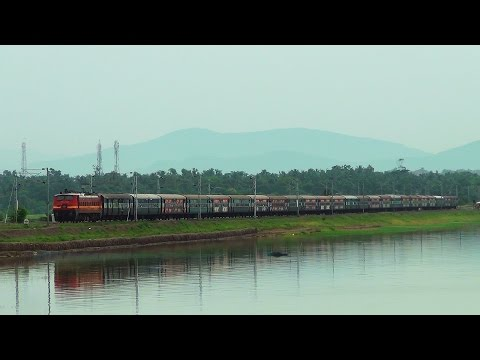 Howrah Chennai Mail on 114th birthday lead by LGD WAP4 through beautiful Chilika Lake