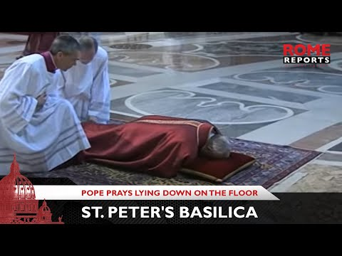 Pope prays lying down on the floor of St. Peter's Basilica