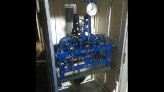Natahování hodinového stroje obecních hodin.