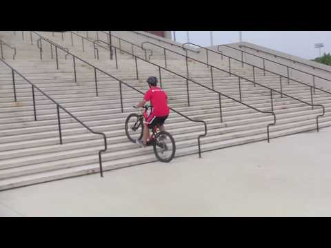 UMD Student Glides Up the Xfinity Center Stairs on 408R E-Mountain Bike