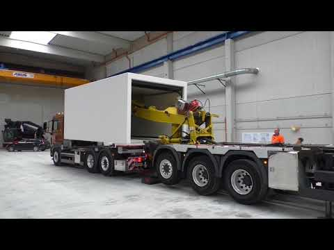 Loading a precast concrete garage onto a truck
