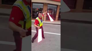 Parking lot attendant with real lightsabers