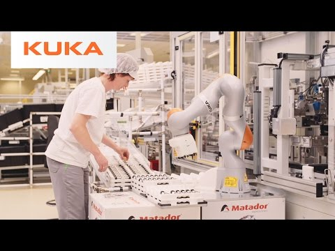People Work Directly with Robots Building Volkswagen Transmissions