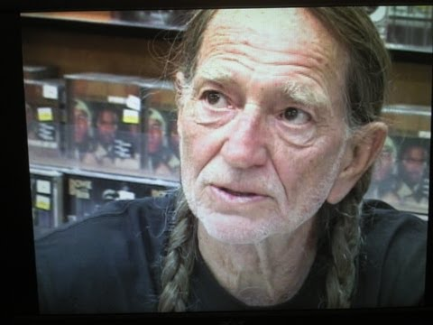 WILLIE NELSON meets fans at music store