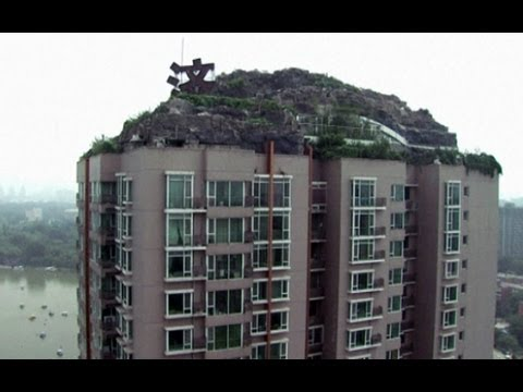 Man builds mountain lair atop city block in China