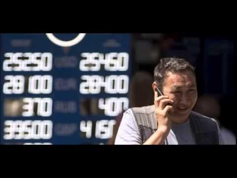 Kazakhstan joins currency war, devalues tenge